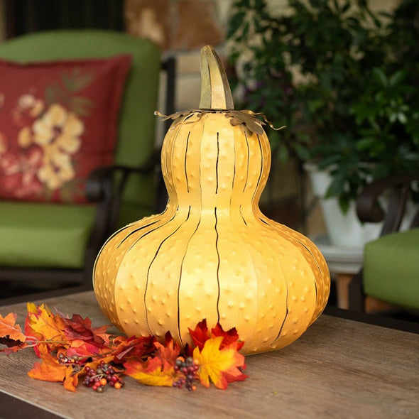 Yellow Gourd Luminary on endtable with chair in background