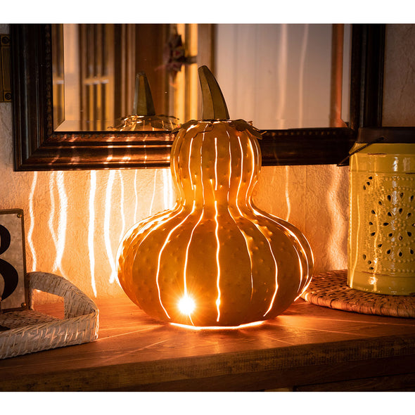 Yellow Gourd Luminary, lit, on kitchen counter