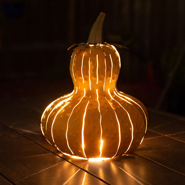Gourd Luminary lit up with streaks of light