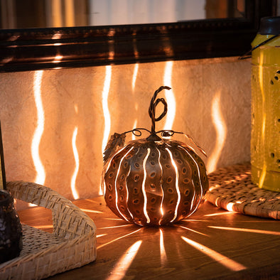 Mini Pumpkin Luminary lit up with streaks of light
