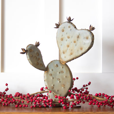 Prickly Pear Heart sculpture on table top