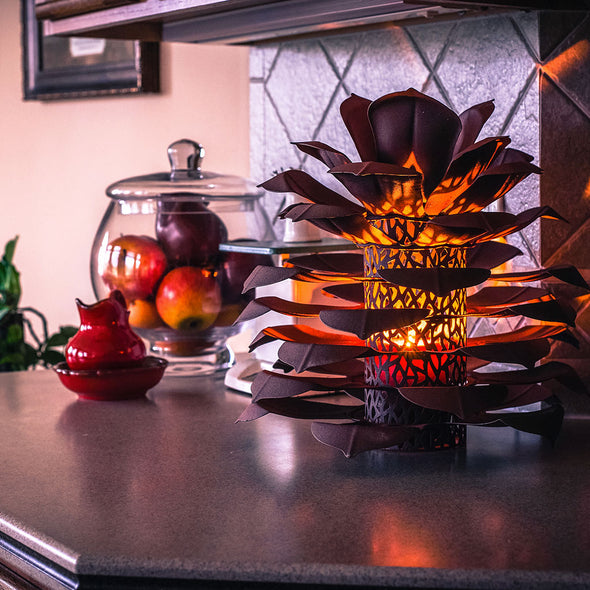 Pinecone Luminary lit up on kitchen counter