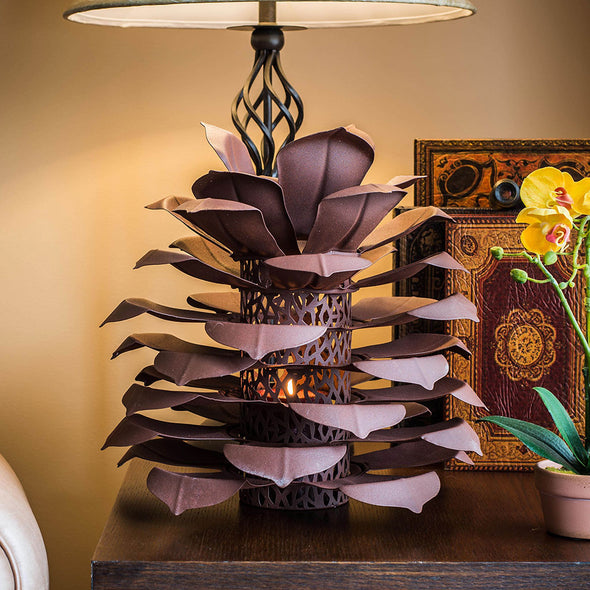 Pine Cone Luminary next to lamp on end table