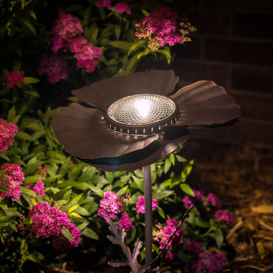 Bronze Poppy Solar Light in flower bed