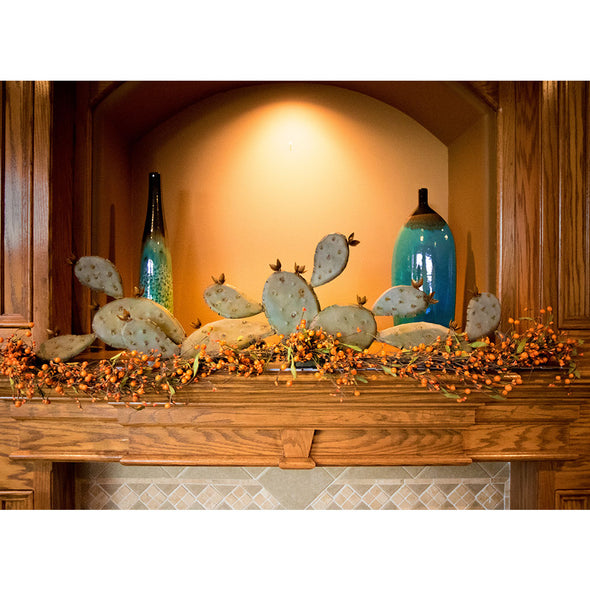 Prickly Pear Mantel Sculpture with accent lighting above fireplace