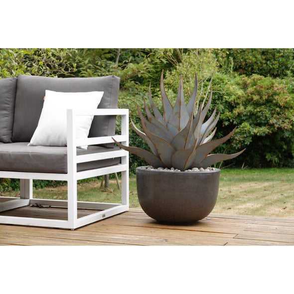 Metal Agave in pot next to patio furniture