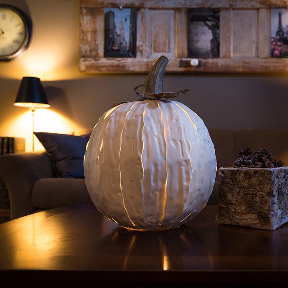White Squatty Pumpkin Luminary lit in interior scene