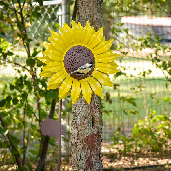 Yellow Sunflower Garden Stake Bird Feeder in backyard with bird perched