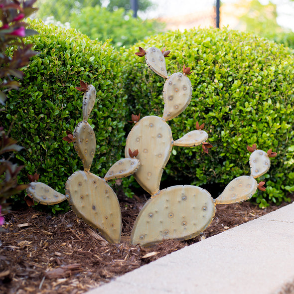 Prickly Pear sculpture in landscape bed - Ancho