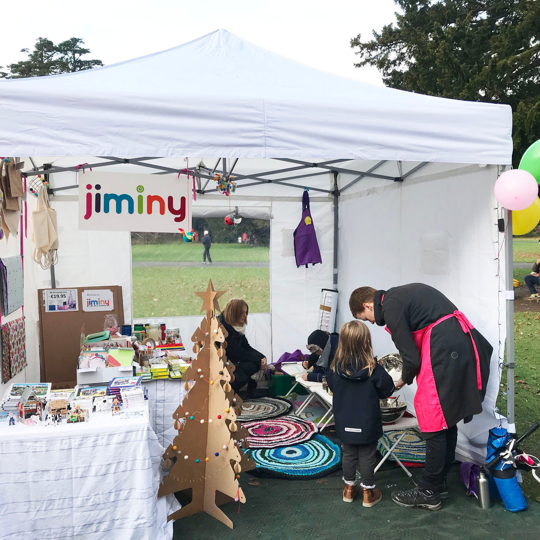 Jiminy market tent at St Anne's Market Red Stables Raheny. Market stall with eco friendly craft products, craft experience for children, cardboard christmas tree