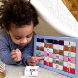 Child plays with PLAYin CHOC plastic-free advent calendar