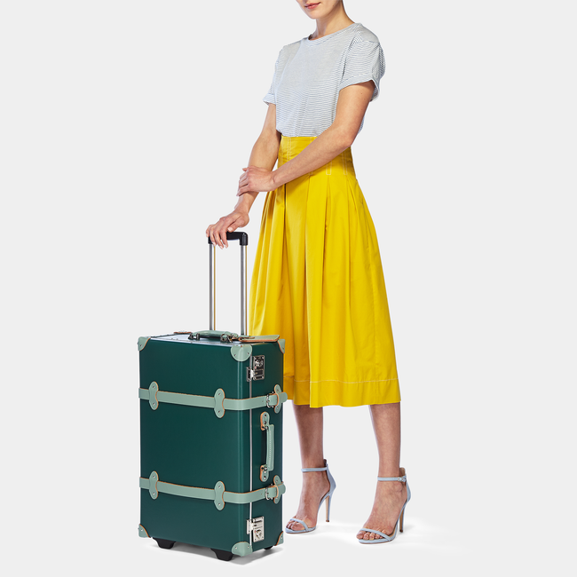 The Artiste Stowaway in Green - Old Fashioned Suitcase - Exterior Front with Model