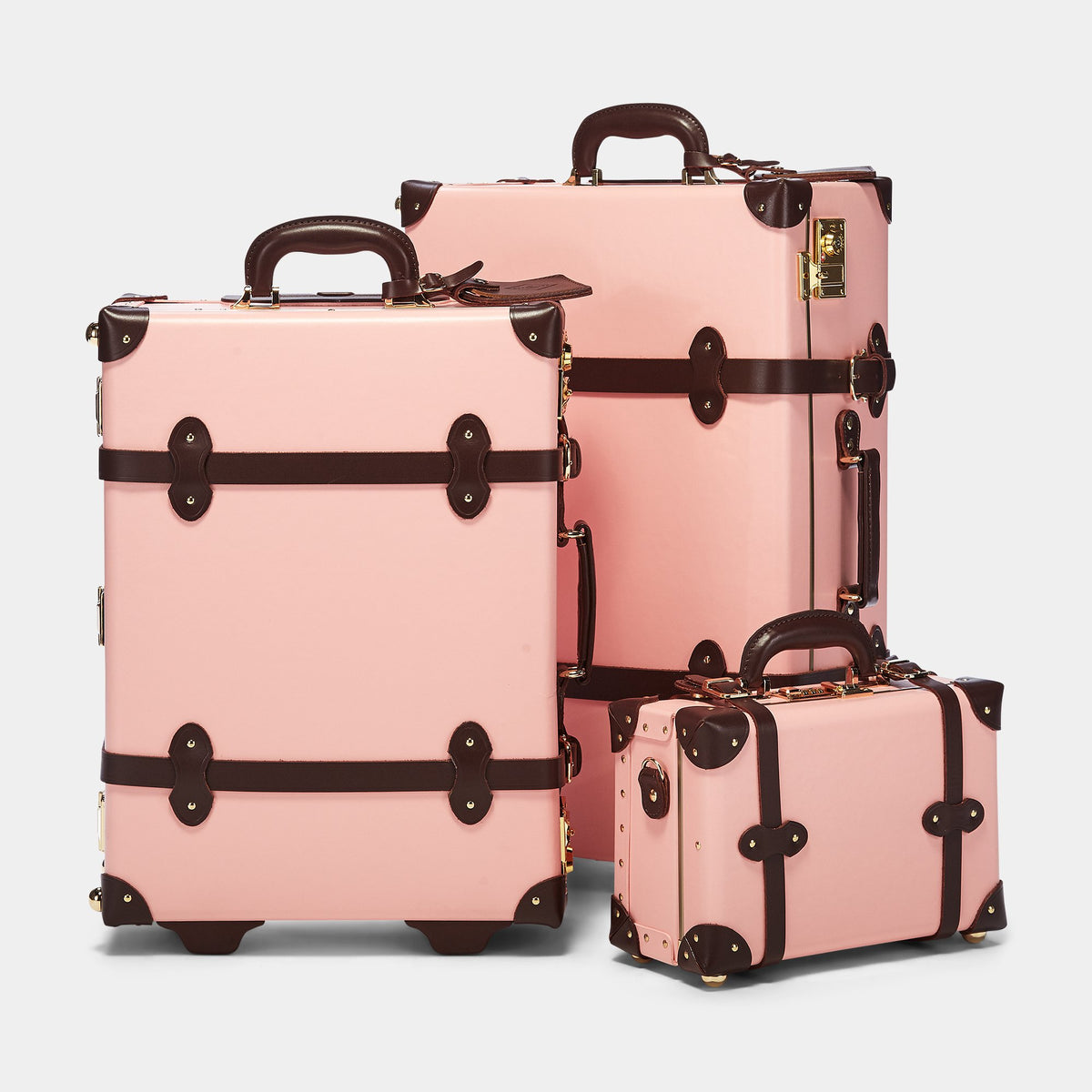 The Artiste Stowaway in Pink - Old Fashioned Suitcase - Alongside matching cases from the Artiste Pink collection