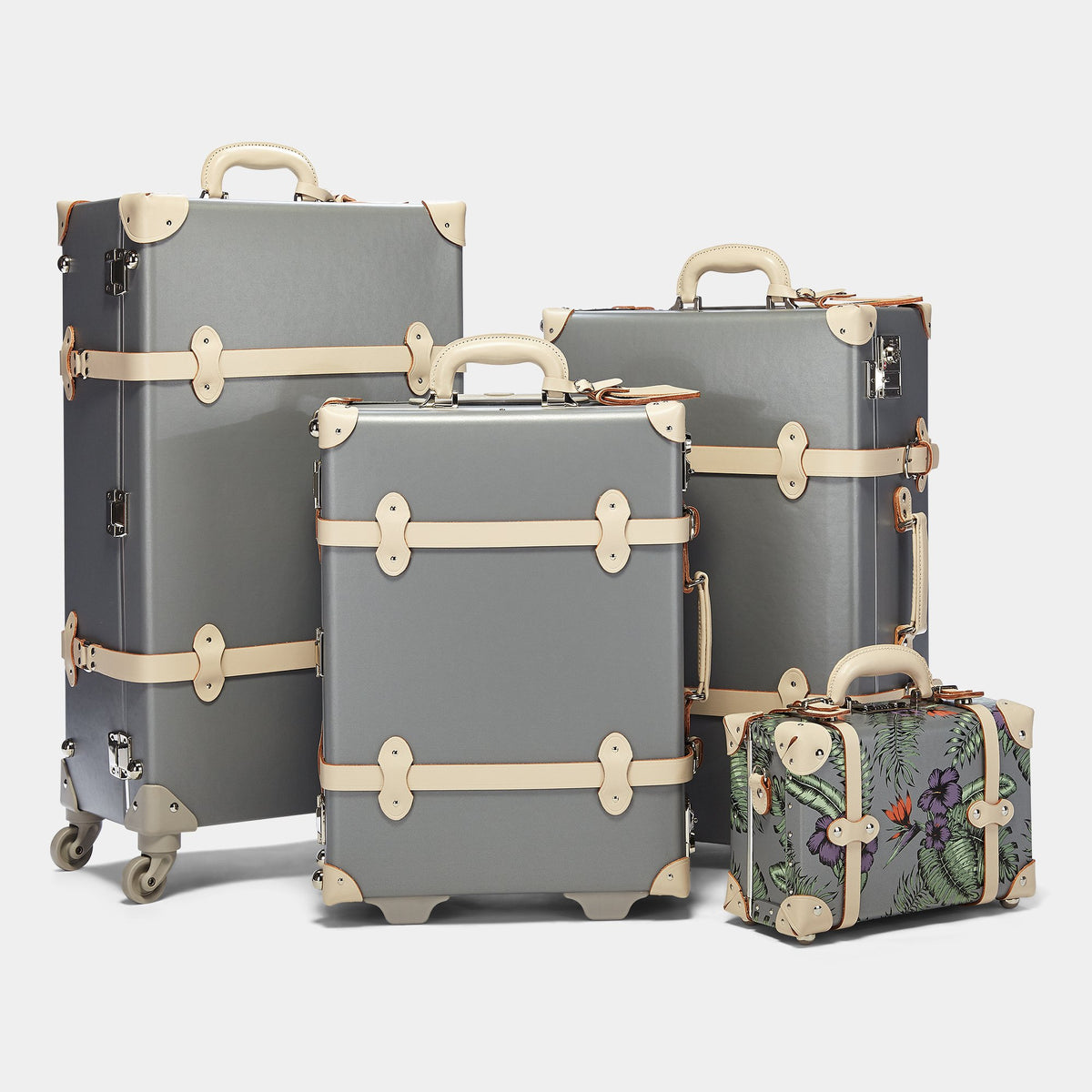 The Botanist Spinner in Grey - Vintage-Inspired Suitcase - Alongside matching cases from the Botanist Grey collection