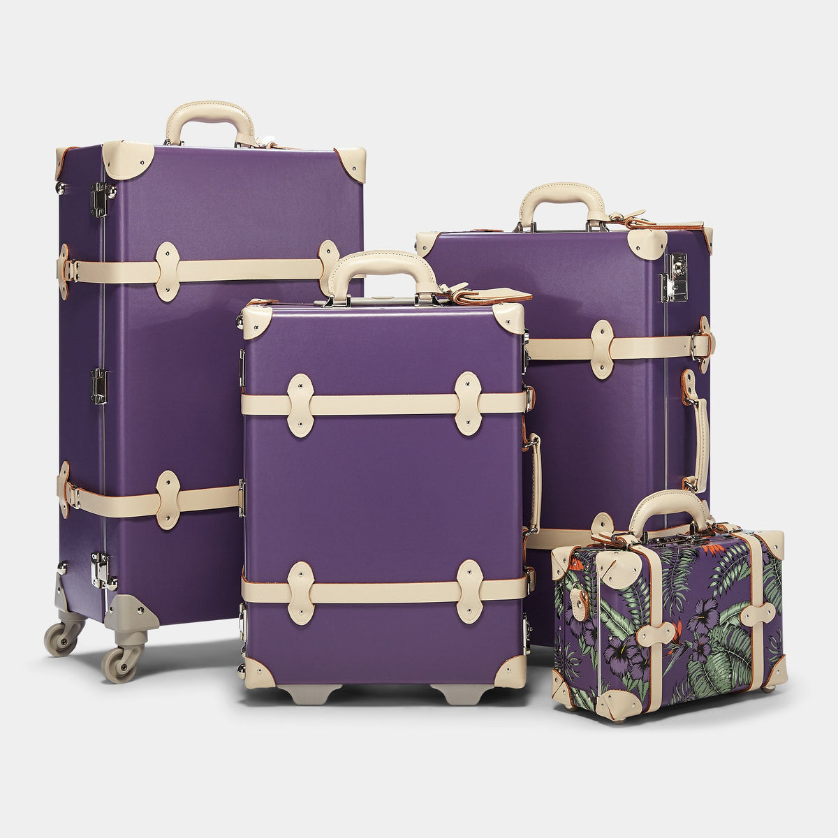 The Botanist Spinner in Purple - Vintage-Inspired Trunk Suitcase - Alongside matching cases from the Botanist Purple collection