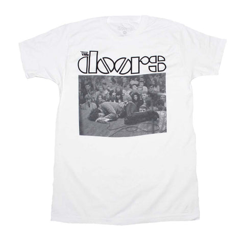 Rock Icon Jim Morrison of The Doors laying on stage printed on a white cotton tee.