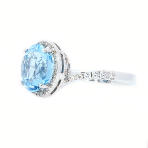Sky Blue Topaz & Diamond Halo Ring