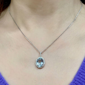 Oval Aquamarine & Diamond Halo Pendant