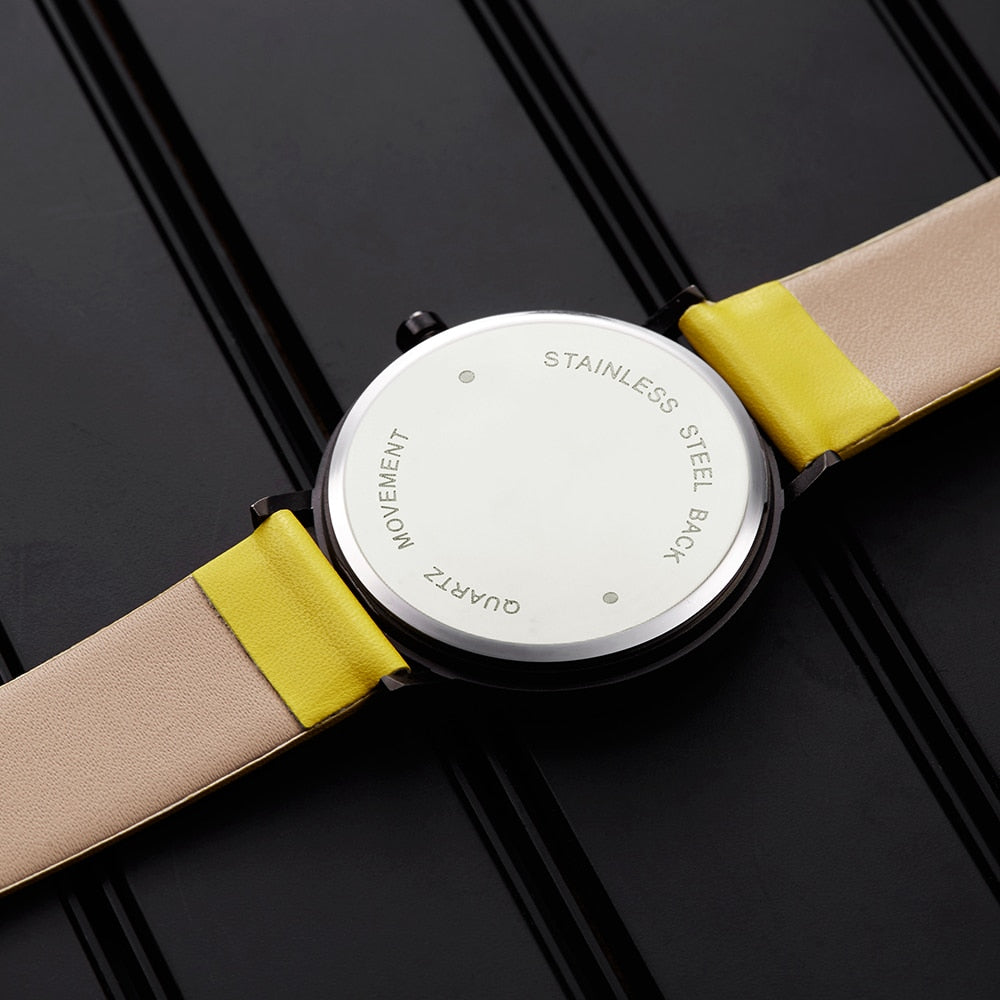watch, rotating dial, rotating clock face, unisex, unisex watch, minimal creative wrist watch, wristwatch, unisex wristwatch, rotating watch display, rotating watch case, rotating bezel watch, rotating dial watch, yellow funky wristwatch, funky yellow wristwatch, black rotating wristwatch, unisex rotating creative dial