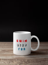 Load image into Gallery viewer, Swim Bike Run Triathlon Mug - Track and Fit Club