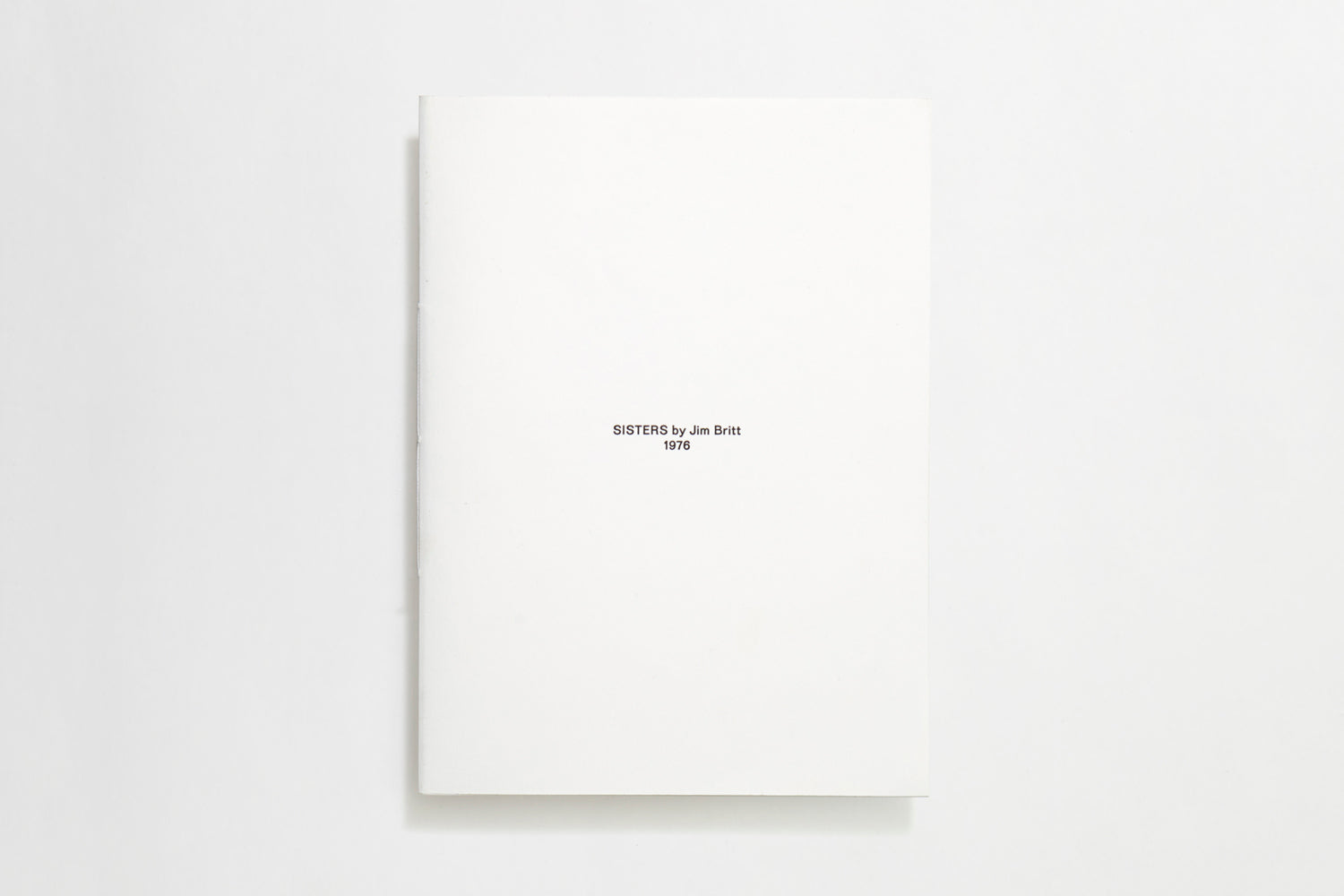 24-page white thread-sewn booklet