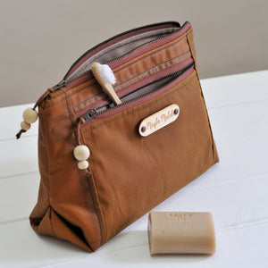 Vegan wax canvas wash bag in caramel close up