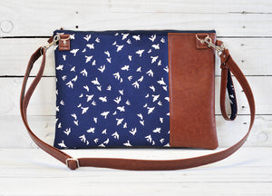 Recycled leather laptop crossbody bag navy bird strap view