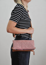 Load image into Gallery viewer, Recycled leather fold over clutch purse red shibori on model