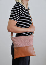 Load image into Gallery viewer, Recycled leather fold over crossbody purse red shibori on model