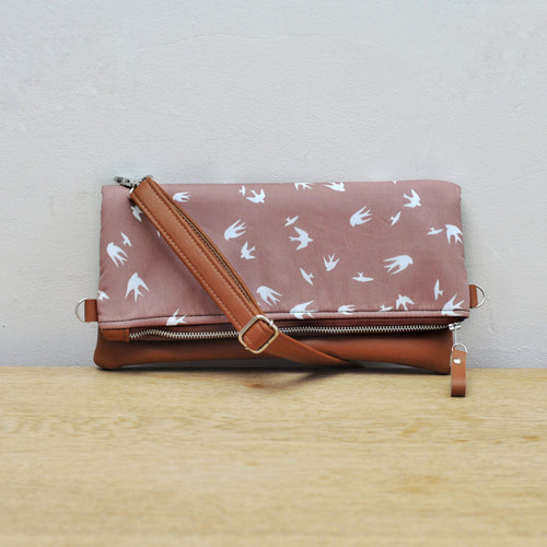 Recycled leather fold over bag in taupe bird