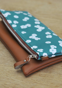Recycled leather fold over clutch bag in teal flower close up