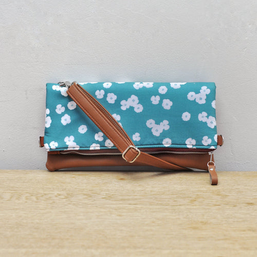 Recycled leather fold over clutch bag in teal flower