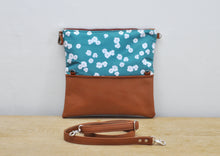 Load image into Gallery viewer, Recycled leather fold over clutch bag in teal flower unfolded view