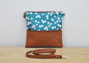 Recycled leather fold over clutch bag in teal flower unfolded view