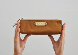 Wax canvas pencil case in caramel held view