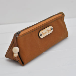 Wax canvas pencil case in caramel close up