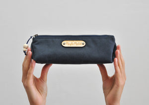 Wax canvas pencil case in navy held view