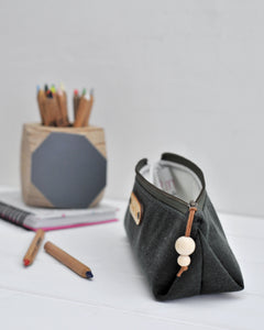 Wax canvas pencil case in green side view