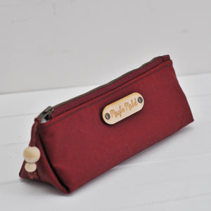 Wax canvas pencil case in red side view