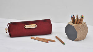 Wax canvas pencil case in red with props