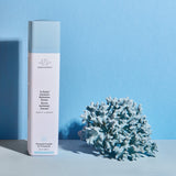 B-Hydra Intensive Hydration Serum Bottle against a blue background with blue coral
