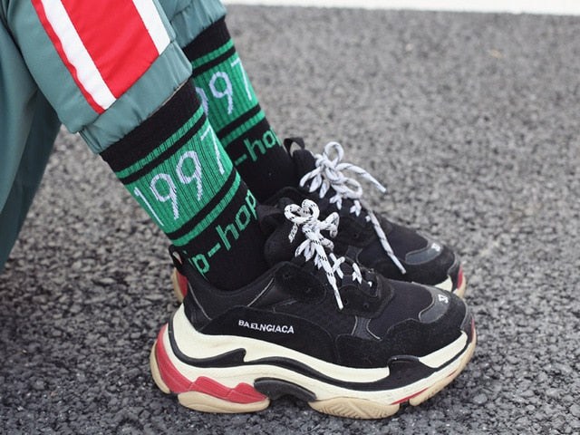 model with black and green 1997 hip hop socks