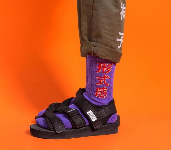 Purple socks with red mandarin kanji worn by model