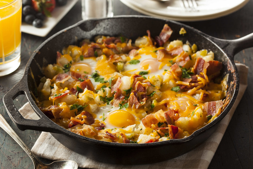 Tasty Breakfast Skillet With Bacon, Egg, Potato, And Cheese