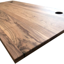 Load image into Gallery viewer, Solid walnut desktop with cable ports for the Aura standing desk