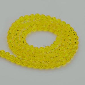 Faceted Glass Crystal 4mm Round Yellow 98+ per Strand