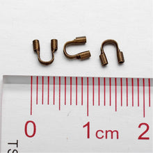 Load image into Gallery viewer, Packet of 150+ Antique Bronze Plated Brass 5 x 6mm Wire Guardians