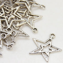 Load image into Gallery viewer, Pack of 25 Tibetan Silver 23mm Star Pendants Charms