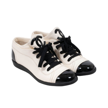 Low Top Leather Sneakers (Cream/Black) CHANEL