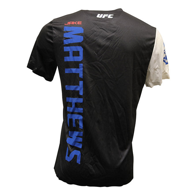 "Jake Matthews Autographed Event Worn Jersey, Inscribed ""Live the Dream, TCK"" from UFC 193"